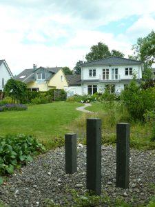 Im hinteren Gartenbereich ein Yin-Ort zum Zurückziehen und Entspannen.